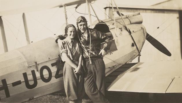 Nancy Bird and Jack Kingsford-Smith standing next to a de Havilland DH.60M Moth (VH-UOZ), Mascot [?], New South Wales, ca. 1933, 1 / E. A. Crome
