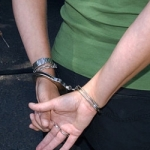 640px-Demo_arrest_handcuffed-620x250