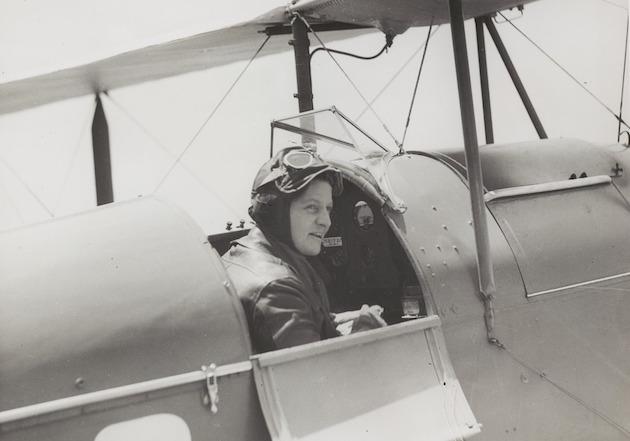 Freda Thompson sitting in the cockpit of a de Havilland DH.60G-III Moth Major, ca 1935